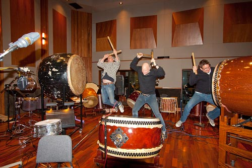 Percussionists Bruce Carver, MB Gordy and Pete playing huge drums at The Bridge Recording Studio. John Rodd engineered.
