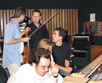 Mark Robertson, Ceiri Torjussen, Julia Newmann, Cody Westheimer and John Rodd all discussing a cue at Capitol studios during the scoring session for SMILE