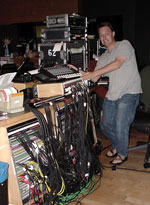 <i>Planet of the Apes</i> (2001) - note the massive amount of cables in the patchbay. John is holding the Mackie mixer he used to manage all the click track sources used at various times during the recording and mixing of the score  - two Auricle rigs, two different clicks from Marc Mann's rig, playback from a 24 track analog, playback from a 48 track digital machine.
